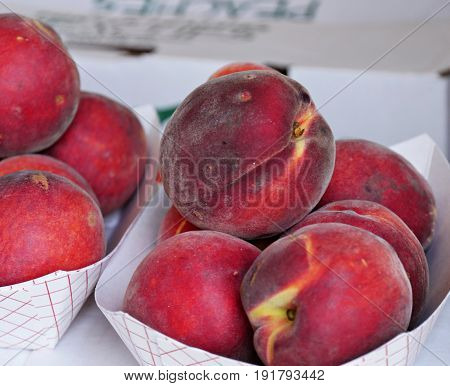 Ripe peaches in boxes, close up Close up of ripe red peaches in small boxes