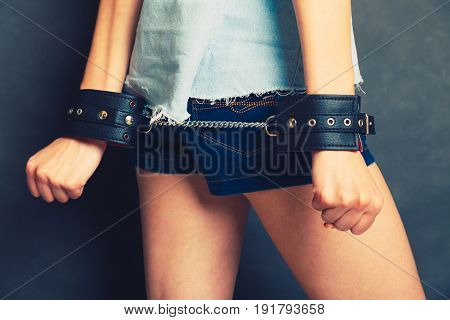 Arrested girl with handcuffs. Punishment woman going to jail.