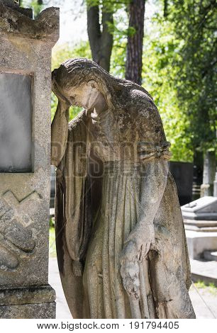 Old Statue On Grave In The Lychakivskyj Cemetery