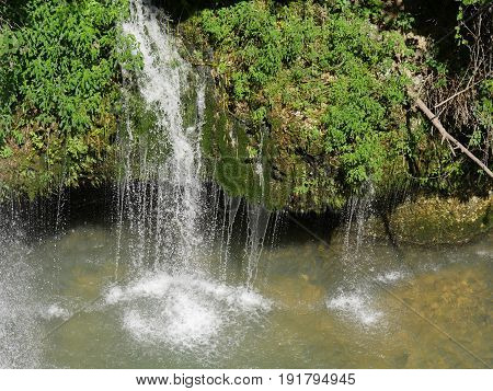 top view of small natural waterfalls Curtains of dripping water from a small waterfall viewed from the top