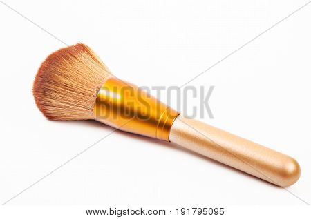 Makeup gold brush powder Blusher on white background.