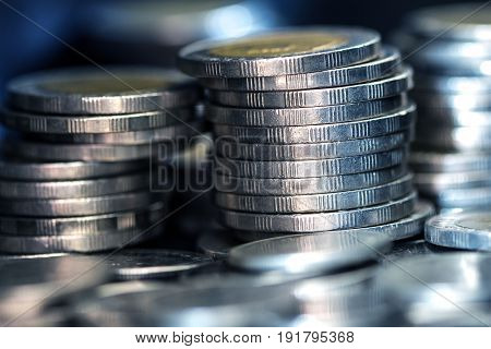 Close up silver money coin stacking on dark background