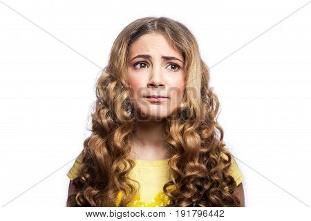 Portrait of thoughtful girl with wavy hairstyle and yellow t shirt. studio shot isolated on white background.