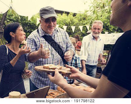 Diverse People Eating Testing Sample Homemade Bread