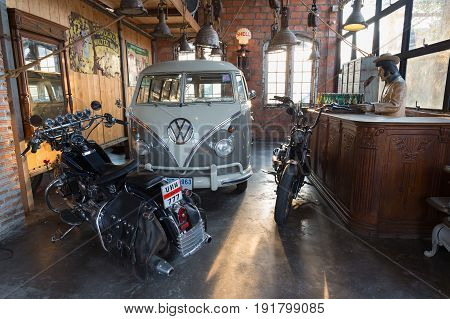 BANGKOK THAILAND - March 26 2017: show old Volkswagen van and old motorcycle at Night market Srinakarin road that name is train market. This market is open every Wednesday to Sunday.