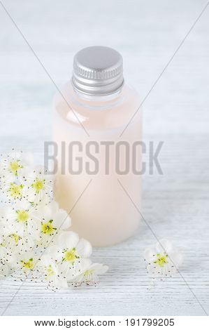 natural hair care bottle shower gel or body lotion with fresh flowers homemade