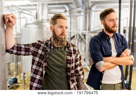 manufacture, business and people concept - men at craft brewery or beer plant