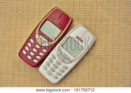 KANCHANABURI THAILAND 18 JUNE 2017 Vintage cellphone NOKIA 3310 on wooden table.