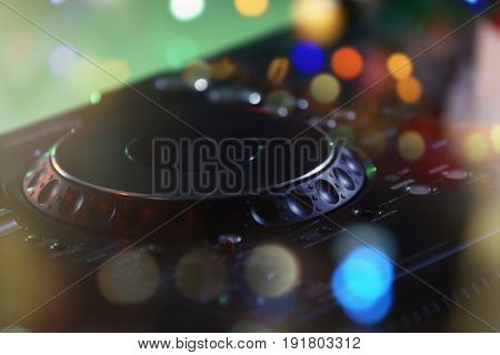 Modern DJ console, closeup. Concept of Christmas music and songs