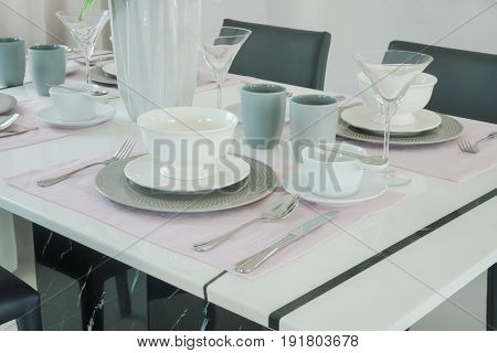 Romantic Dining Set With Beautiful Flower Vase At The Center Of Dining Table