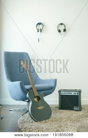 Music Studio With Gray Armchair, Guitar And Headphones