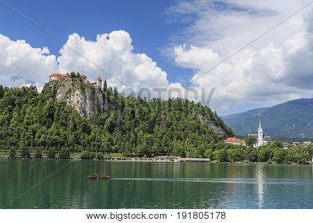 Bled, Slovenia - June 3, 2017: Close Up Of The Church In The Center Of Bled Lake With A Small Boat O