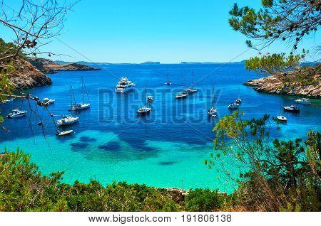 Sailboats at Cala Salada lagoon. Idyllic scenery. Ibiza Balearic Islands. Spain
