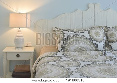 Classic Style Bedding And Reading Lamp With Blue Wall