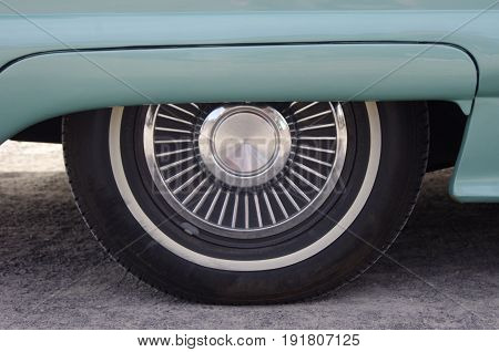 Vintage mint green car with chrome wheel
