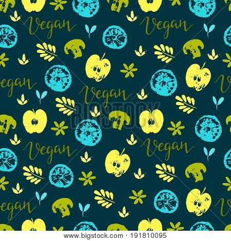 Vector seamless pattern with fruit and vegetables. Apples, lemon, mushrooms and word vegan.  Hand drawn background. Perfect for vegan food menu or surface pattern design.