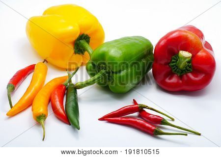 Multiple color Red green yellow chilli bell and bird's eye pepper isolated on white background