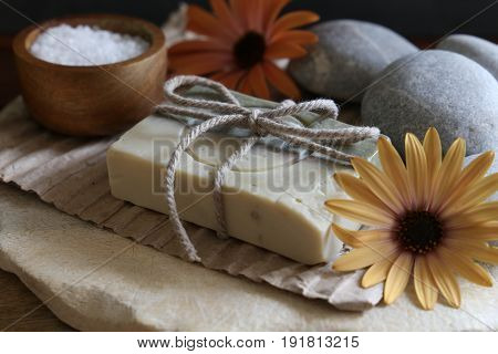 Set spa and wellness: handmade soap, white stones wooden background