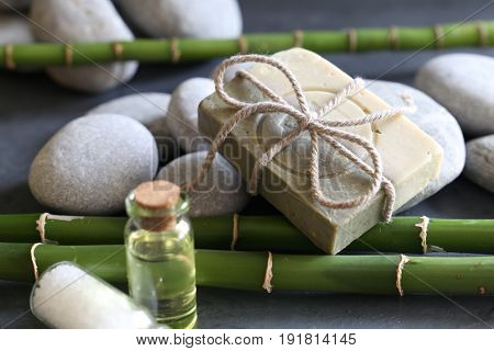 pebble stone with green bamboo and soap
