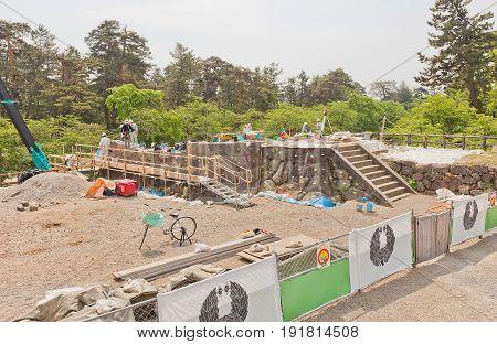 HIROSAKI JAPAN - MAY 23 2017: Reconstruction works of foundation of main keep and stone walls of Hirosaki Castle Hirosaki Japan