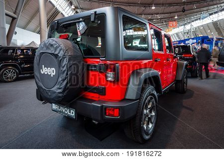 STUTTGART GERMANY - MARCH 03 2017: Mid-size SUV Jeep Wrangler Unlimited Rubicon 2016. Rear view. Europe's greatest classic car exhibition