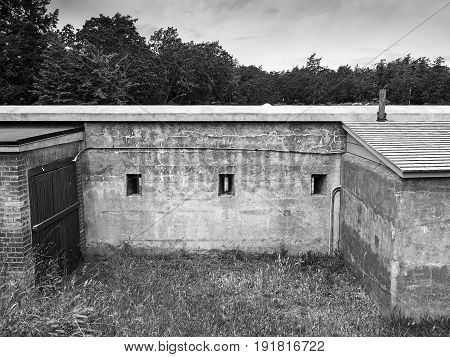 Old ilitary fort wall with riffle slits black and white