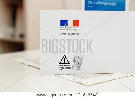 PARIS FRANCE - OCT 26 2016: Special postal envelope with the logo of The Ministry of the Interior (Ministere de l'Intérieur) with the special mark that vehicle registration certificate is enclosed