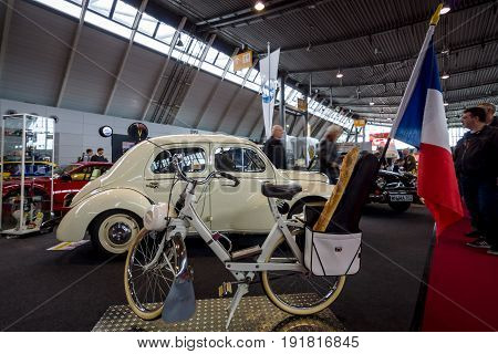 STUTTGART GERMANY - MARCH 03 2017: Motorised bicycle Velo Solex S3800 1970. Europe's greatest classic car exhibition