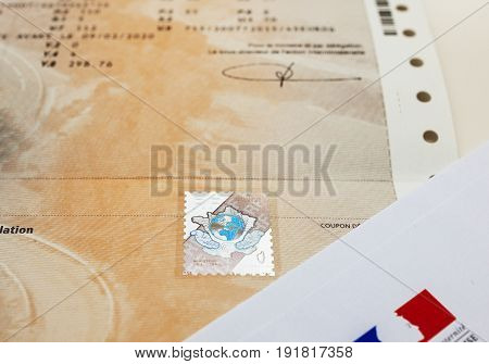 PARIS FRANCE - OCT 26 2016: Front view of the vehicle registration certificate (certificat d'immatriculation known also as carte grise) with special holographic protection stamp issued by the Ministry of Interior of France