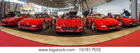 STUTTGART GERMANY - MARCH 03 2017: Various Ferrari cars standing in a row. Panoramic view. Europe's greatest classic car exhibition