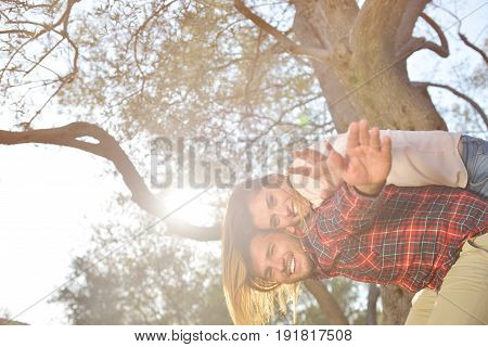 couple relax under the tree. Fine art style. Olive garden