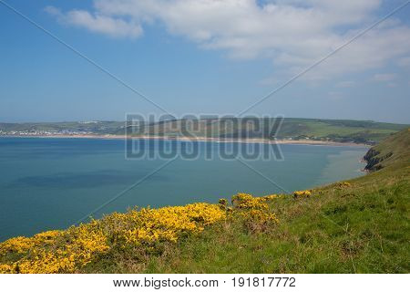 View from coast path to Woolacome Devon England UK in summer with blue sky