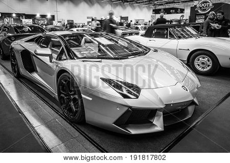 STUTTGART GERMANY - MARCH 03 2017: Sports car Lamborghini Aventador LP 700-4 2014. Black and white. Europe's greatest classic car exhibition