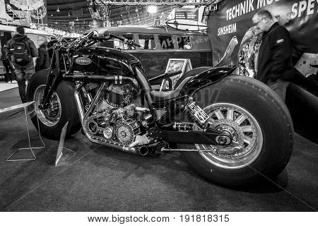 STUTTGART GERMANY - MARCH 03 2017: The world's biggest running motorcycle Leonhardt Gunbus 410. Black and white. Europe's greatest classic car exhibition