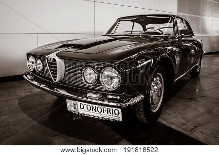 STUTTGART GERMANY - MARCH 03 2017: Executive car Alfa Romeo 2600 Sprint (Tipo 106) 1962. Sepia toning. Stylization. Europe's greatest classic car exhibition