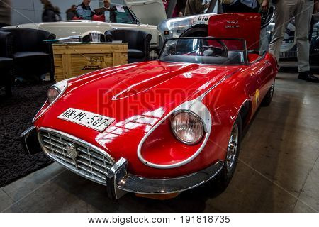 STUTTGART GERMANY - MARCH 03 2017: Child car Jaguar E-Type. Europe's greatest classic car exhibition