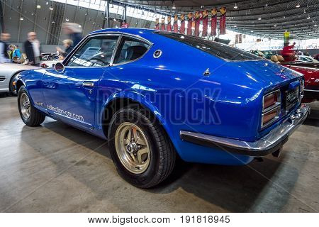 STUTTGART GERMANY - MARCH 03 2017: Sports car Datsun 260Z (Nissan S30) 1976. Rear view. Europe's greatest classic car exhibition