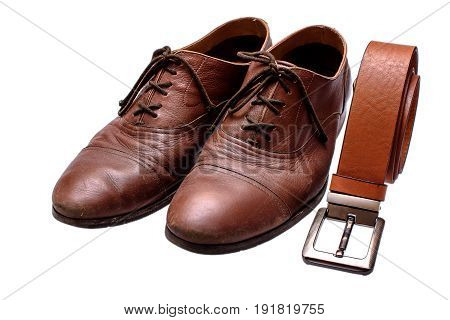 Old Brown Shoes And Brown Belt On An Isolated White Background