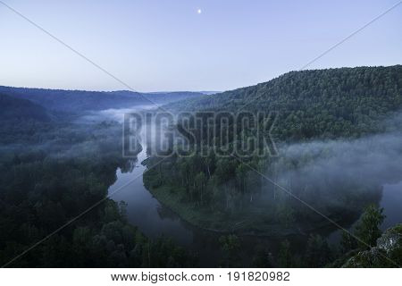 Ecological place Berdsky rocks . Early foggy morning. Trees and a river in the fog. Russia, Siberia, Novosibirsk region, Iskitimsky district.