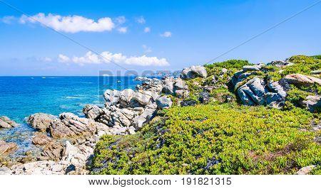 Granite rocks coastline and amazing azure water on beautiful Sardinia island near Porto Pollo, Sargedna, Italy.