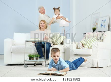 Grandson looking through photo album at home