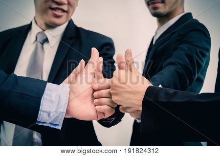 Many business people are handing thumbs up.