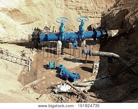 Oil, Gas, Water Industry. Wellhead With Valve Armature Underground. Dug Deep Trench