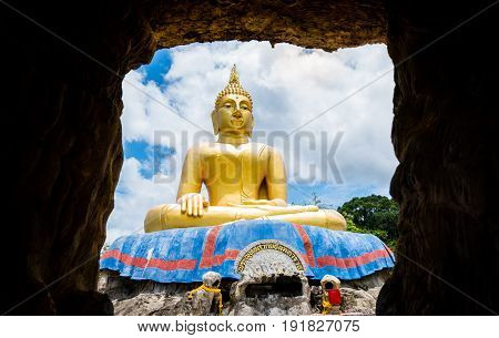 Big Buddha statue viewed from the cave in Hua Hin THAILAND