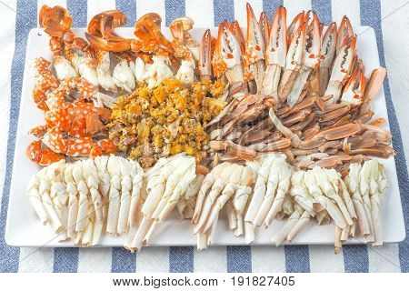 Streamed crabs Thai seafood top view on stripes cloth background