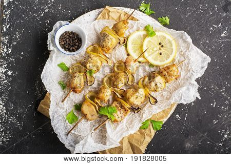 Lemon chicken kebabs with honey glaze and parsley and pepper. Top view.