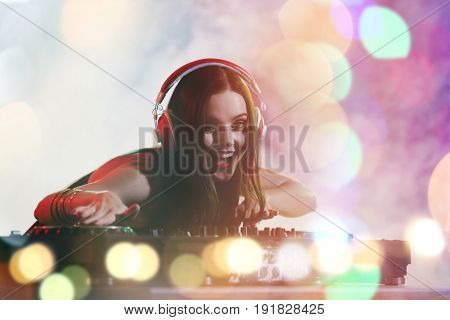 Young DJ performing in nightclub. Concept of Christmas music and songs