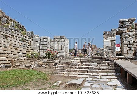 EPHESUS, TURKEY - APRIL 30, 2012: Unidentified tourists in Ruins of st. Johns Basilica at Ayasuluk Hill - Selcuk, Ephesus, Turkey