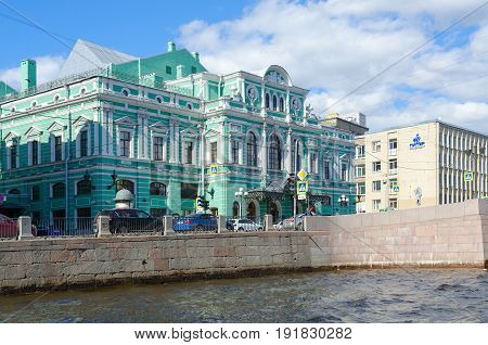 SAINT PETERSBURG RUSSIA - MAY 3 2017: Russian State Academic Great Drama Theater named after G.A. Tovstonogov embankment of Fontanka River St. Petersburg. Unknown people walking down street