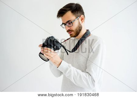 Portrait of male photographer with digital camera